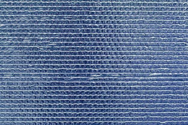 Lśniące Wypukłe Niebieskie Tło Folii. Premium Zdjęcia