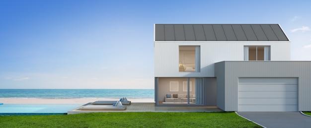 Luksusowy Dom Przy Plaży Z Basenem I Garażem W Nowoczesnym Stylu. Premium Zdjęcia