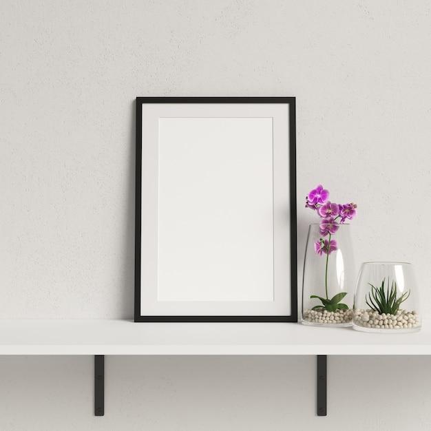 Makieta ramki na białej półce z minimalistycznym dekoracje roślin Premium Zdjęcia