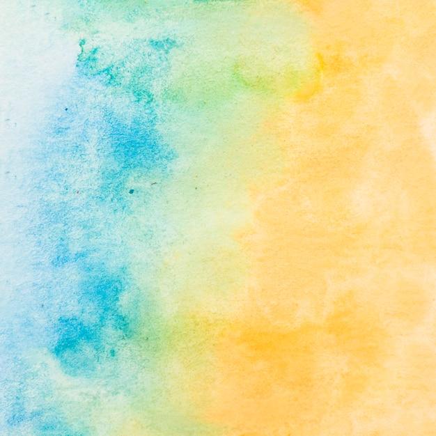 Malujący textured papier z błękitnym i żółtym wodnego koloru tłem Darmowe Zdjęcia