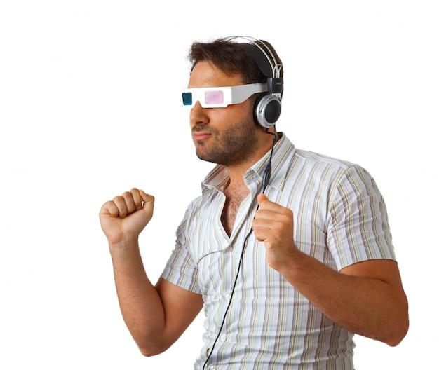 Mężczyzna jest ubranym 3d szkła i słuchawki Premium Zdjęcia