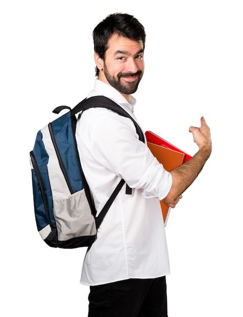 Mężczyzna Studenta Wskazującego Z Powrotem Darmowe Zdjęcia