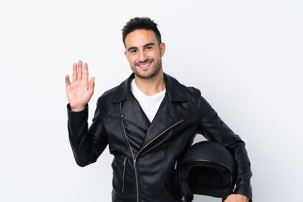 Mężczyzna W Kasku Motocyklowym Pozdrawiając Ręką Z Happy Wypowiedzi Premium Zdjęcia