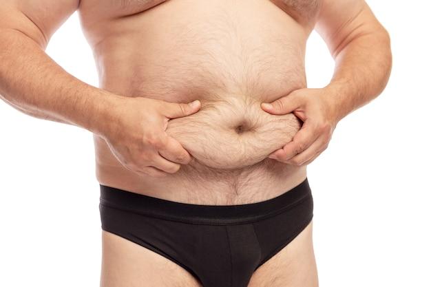 Mężczyzna z dużym brzuchem. Premium Zdjęcia
