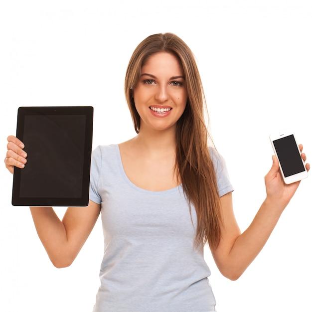 Młoda caucasian kobieta z urządzeniami Darmowe Zdjęcia