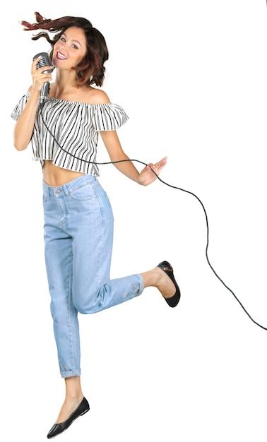Młoda Dziewczyna Z Mikrofonem śpiewa Premium Zdjęcia