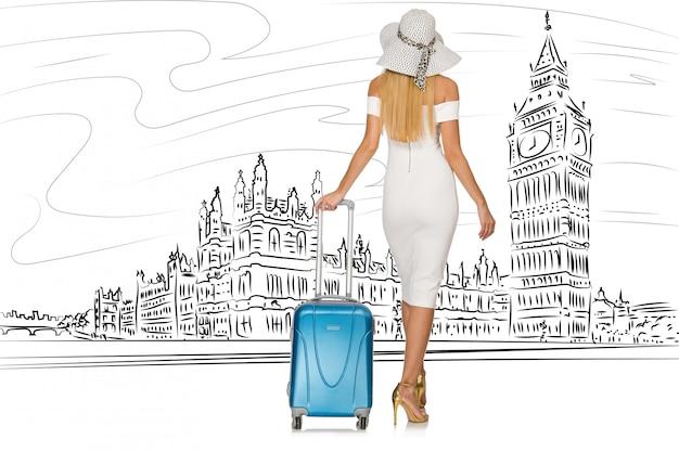 Młoda kobieta podróżuje do londynu w wielkiej brytanii Premium Zdjęcia