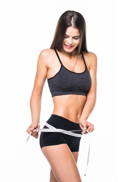 Młoda Kobieta Z Pięknego Ciała Pomiarowym Udem Z Pomiarowym Typ Po Diety, Odosobnionej Na Bielu Darmowe Zdjęcia
