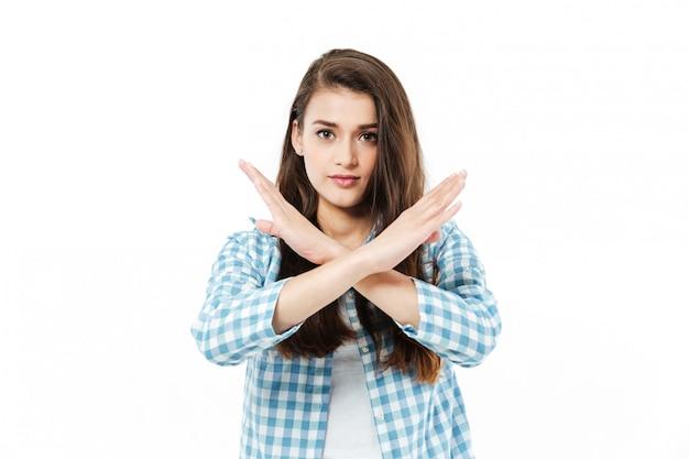 Młoda ładna Młoda Kobieta Krzyżuje Ręce, Aby Pokazać Gest Nr Darmowe Zdjęcia
