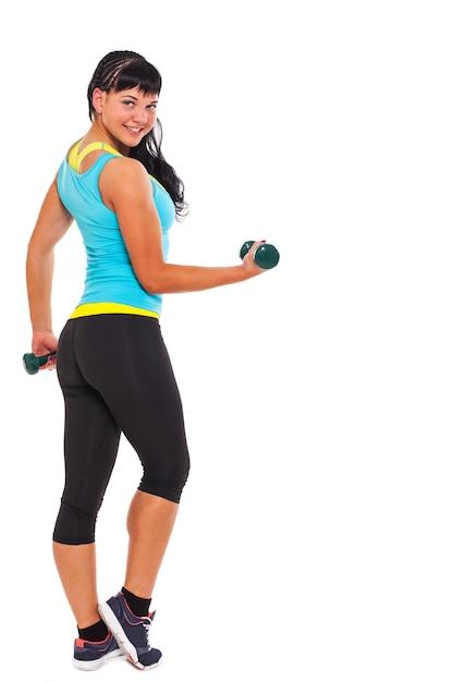 Młoda szczęśliwa brunetka ćwiczy z dumbbells Darmowe Zdjęcia