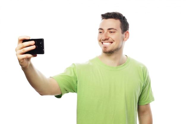 Młody Człowiek Robi Sobie Zdjęcie Premium Zdjęcia