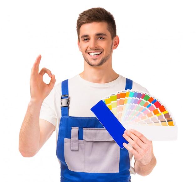 Młody projektant człowieka w odzieży roboczej. Premium Zdjęcia
