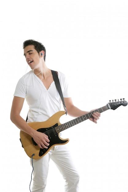 Muzyk młody człowiek bawić się gitarę elektryczną Premium Zdjęcia