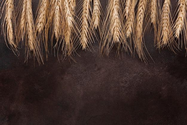 Nasiona pszenicy na teksturowanej tło Darmowe Zdjęcia