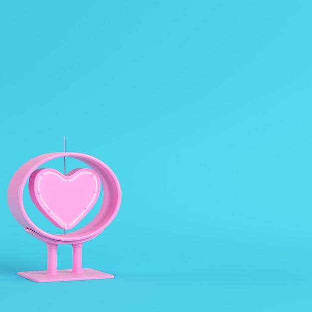 Neonowe, Różowe Serce W Ramce Na Jasnym Niebieskim Tle Premium Zdjęcia