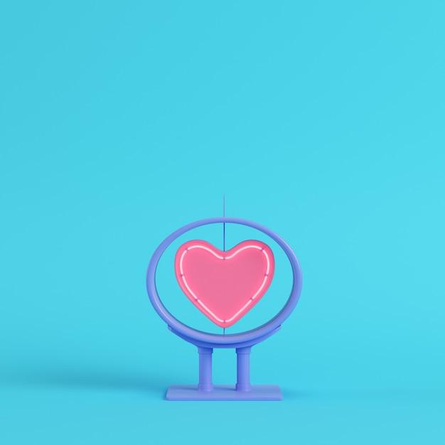 Neonowy Kształt Serca W Ramce Na Jasnym Niebieskim Tle Premium Zdjęcia