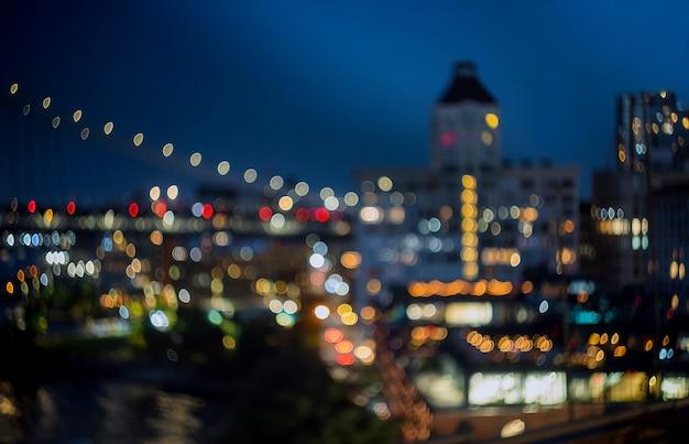 New york skyline noc niewyraźne światła miasta centrum Premium Zdjęcia