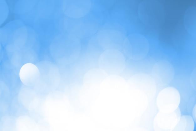Niebiesko-biały Bokeh Okrągły. Premium Zdjęcia