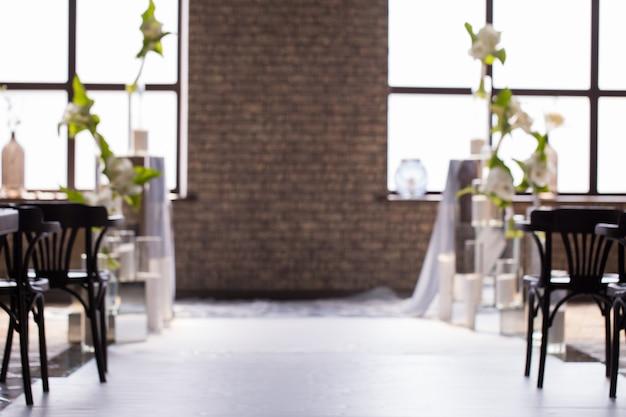 Niewyraźne tło z wesele wystrój dla pary młodej. Premium Zdjęcia