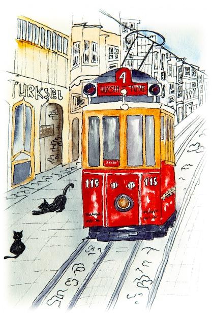 Nostalgiczny czerwony retro tramwaj na słynnej ulicy istiklal. Premium Zdjęcia