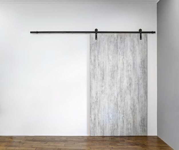 Nowoczesne Drzwi Przesuwne Szary Na Białej ścianie Premium Zdjęcia
