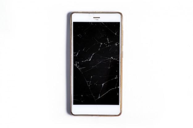Nowoczesny Mobilny Smartfon Dotykowy Z Ekranem Potłuczonego Szkła Na Białym Tle. Koncepcja Serwisu, Naprawy I Technologii Premium Zdjęcia