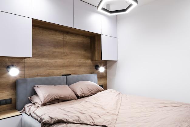 Nowoczesny Projekt Sypialni Z Drewnianą ścianą Premium Zdjęcia
