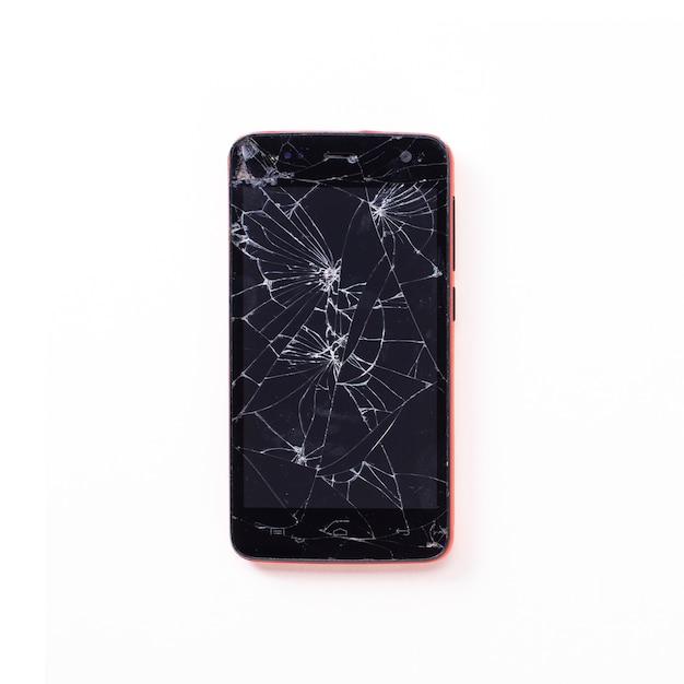 Nowożytny Mobilny Smartphone Z łamanym Ekranem Odizolowywającym. Widok Z Góry Premium Zdjęcia