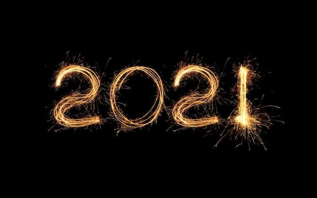 Nowy Rok 2021 światło. Zimne Ognie Rysują Figury 2021. Bengalskie światła I Litery Premium Zdjęcia