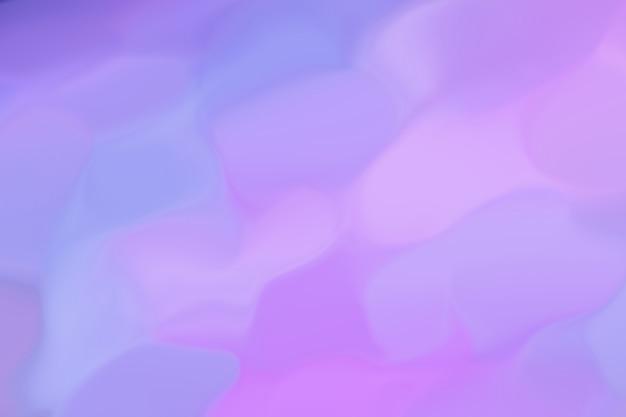 Obraz abstrakcyjny mieni się różnymi kolorami od niebieskiego do różowego do liliowego. wzór nieostre tło. ultramaryna w połączeniu ze światłem neonowym. lata 80-te w stylu retro Premium Zdjęcia