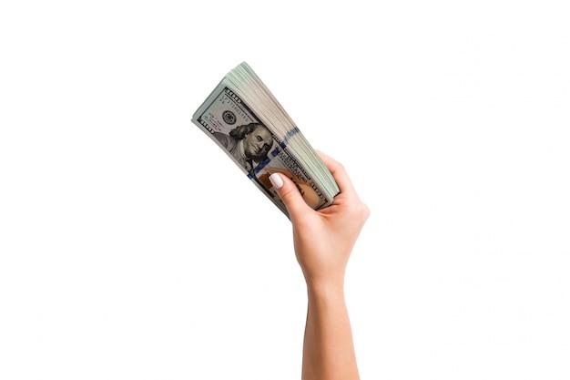 Odosobnionego Wizerunku żeńska Ręka Trzyma Pakietu Dolary Na Bielu. Płatność Z Góry Premium Zdjęcia