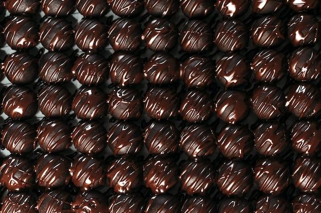 Okrągłe Czekoladki Cukierki Ciemne Tło Luksusowy Deser Ciemna Czekolada Ręcznie Robione Premium Zdjęcia
