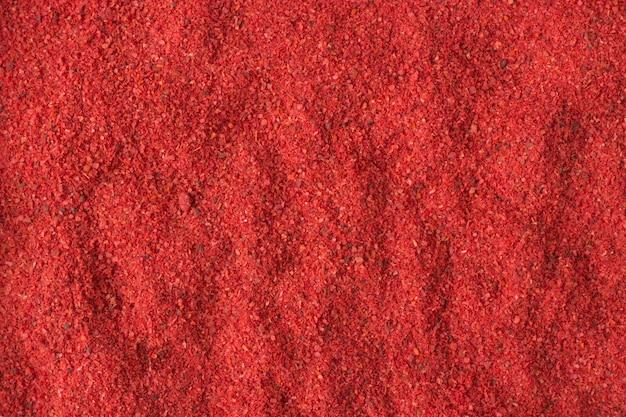 Ostra Papryka Chili W Proszku Jako Tło, Naturalna Tekstura Przypraw Premium Zdjęcia
