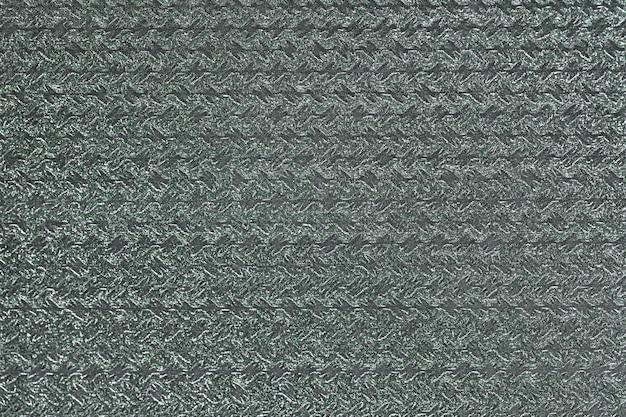 Papier do pakowania prezentów z falistym błyszczącym wzorem. zielone tło Premium Zdjęcia