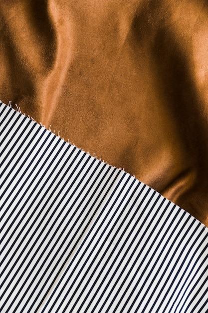 Pasiaste teksturowane tkaniny na serwetach tekstylnych Darmowe Zdjęcia