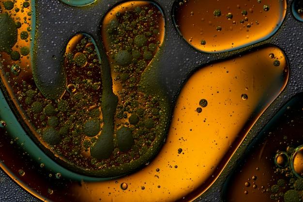 Pęcherzyki świata kolorowe makro streszczenie w tle powierzchni watter Premium Zdjęcia