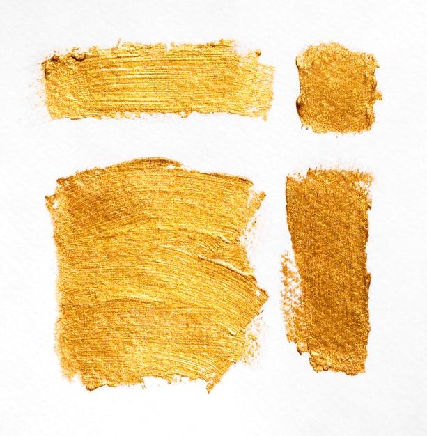 Pędzel Z Drobinami Złotej Tekstury O Różnych Kształtach Darmowe Zdjęcia