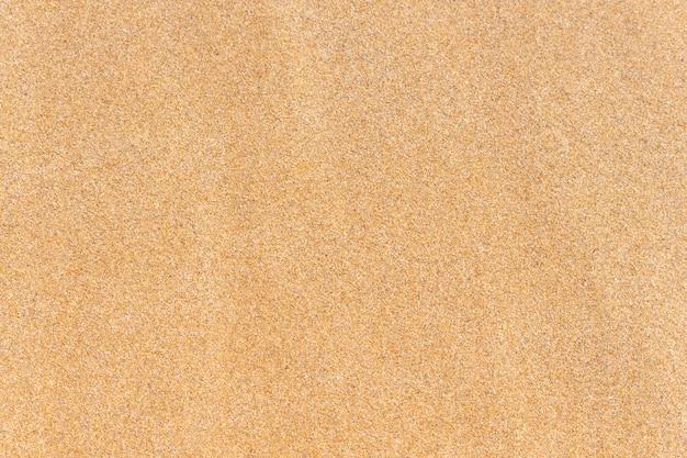 Piasek tekstura. brązowy piasek. widok z góry. Premium Zdjęcia