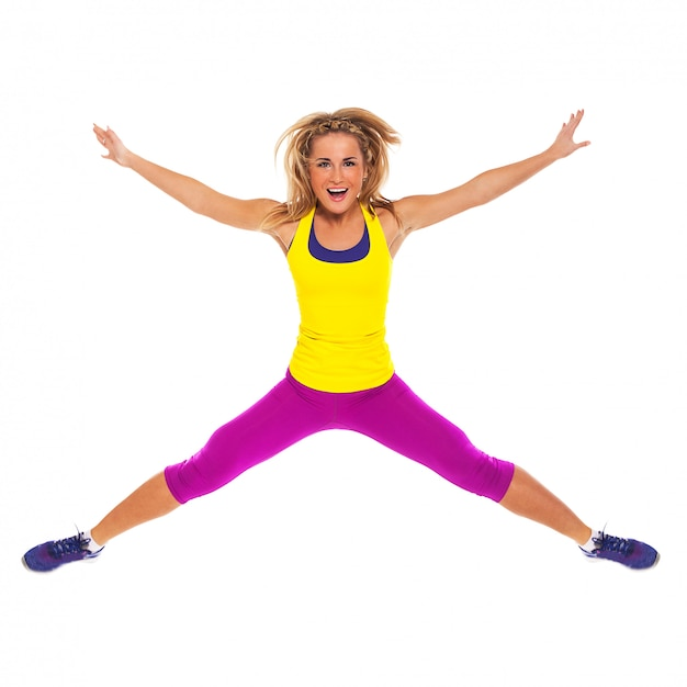 Piękna kobieta w fitness nosić skoki Darmowe Zdjęcia