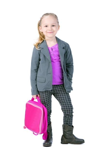 Piękna Mała Dziewczynka Trzyma Teczkę. Premium Zdjęcia