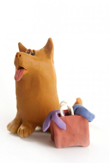 Pies Plastelina Idzie Na Zakupy Z Torbą Premium Zdjęcia