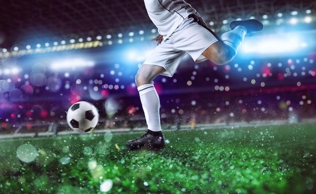 Piłkarz Gotowy Do Kopnięcia Piłki Nożnej Na Stadionie Podczas Meczu. Premium Zdjęcia