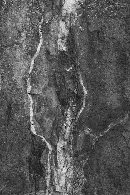 Pionowe Ujęcie Czarnej, Szorstkiej ściany Betonowej Darmowe Zdjęcia