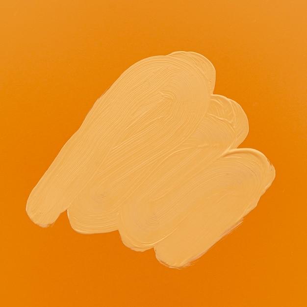 Plama z fundacji na pomarańczowym tle Darmowe Zdjęcia