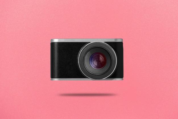 Płaskie Leżało Zdjęcie Aparatu Cyfrowego Na Różowym Tle Premium Zdjęcia