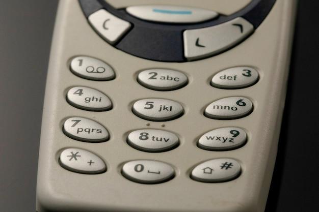 Podkładki Do Telefonów Komórkowych. Przyciski Starego Telefonu Z Bliska Premium Zdjęcia