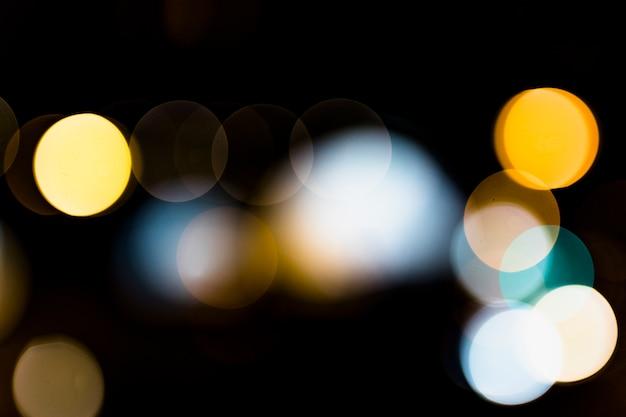 Połysku bokeh światło przeciw na czarnym tle Darmowe Zdjęcia