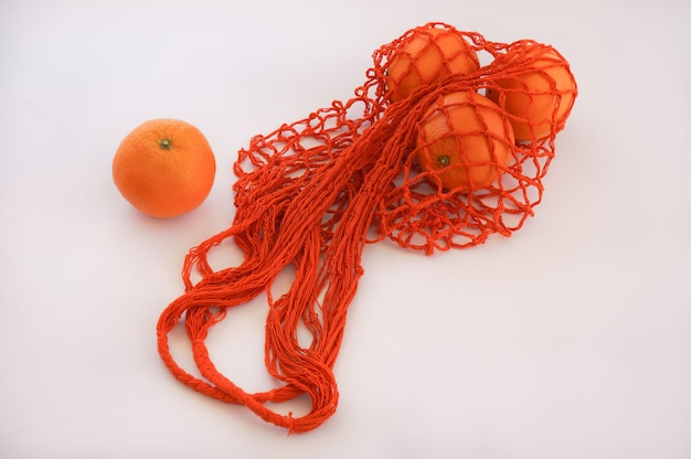 Pomarańczowa torba sznurkowa eco zero waste Premium Zdjęcia