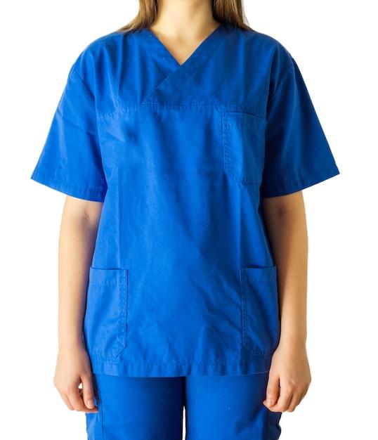 Pomyślna Młoda Kobieta W Niebieskim Mundurze Medycznym Na Białym Tle Darmowe Zdjęcia
