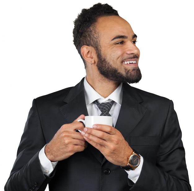 Portret przystojny biznesmen z filiżanką kawy. Premium Zdjęcia